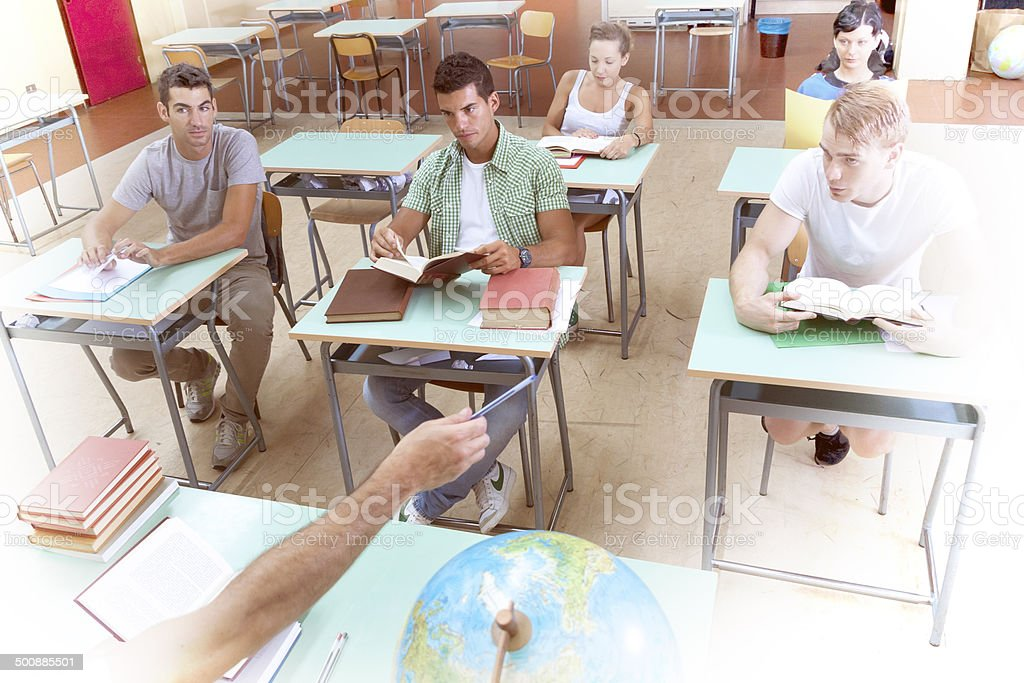 group of students follow the lesson in a classroom stock photo