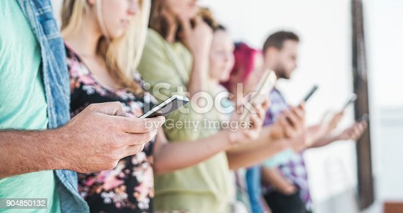 istock Group of students friends using smartphones outdoor - Young people having fun with technology trends - Youth and friendship concept - Focus on left man hand mobile phone 904850132