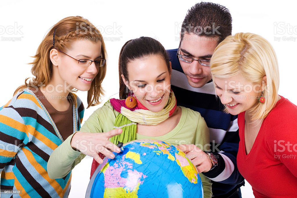 Group of students holding a world globe royalty-free stock photo