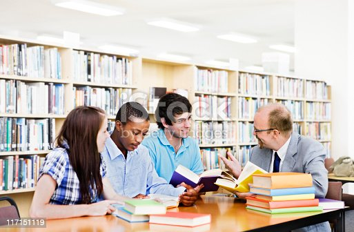 istock Group of students interact with lecturer in library 117151119