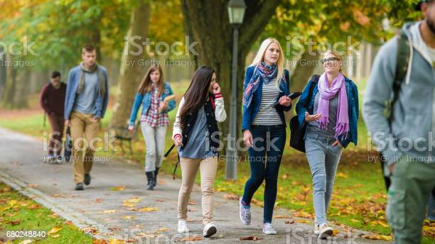 Group of students moving through a park picture id680248840?b=1&k=6&m=680248840&s=612x612&h=fonvscg6uv8ahbh1lsthc1ta9zcvfamvfefz4gccocy=