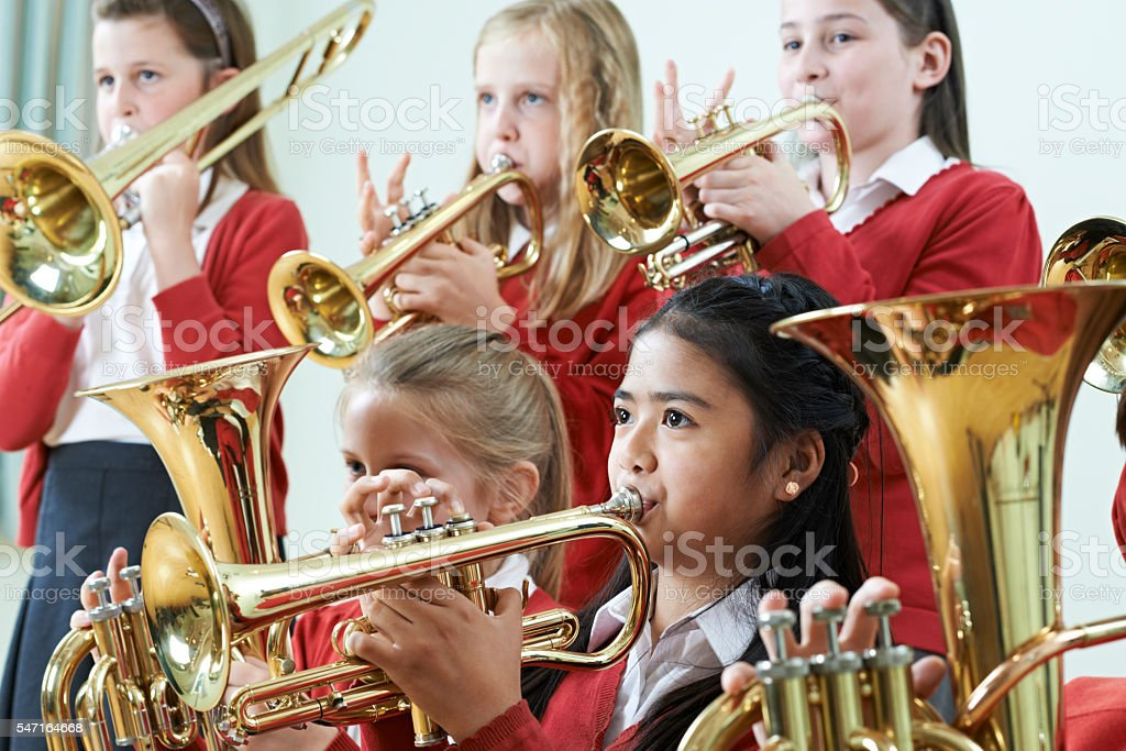 Group Of Students Playing In School Orchestra Together stock photo