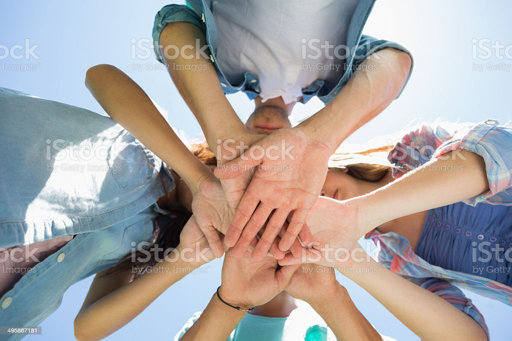 Group of students putting their hands together royalty-free stock photo