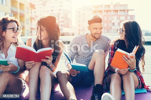 istock Group of students reading books on the rooftop 484095784