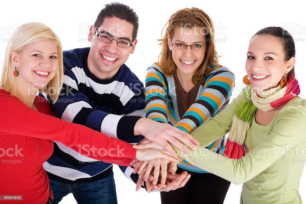 Groupe d'étudiants montrant l'unité avec les mains photo libre de droits