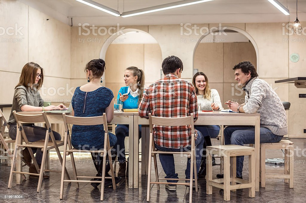 Group of Students sitting at Campus Club Area and discussing stock photo