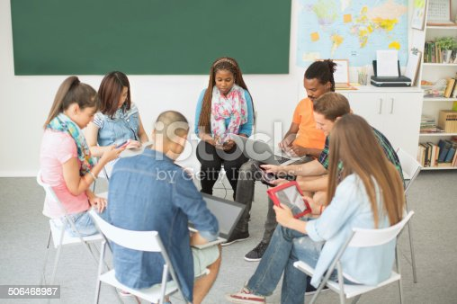 istock Group of students sitting in a circle. 506468987