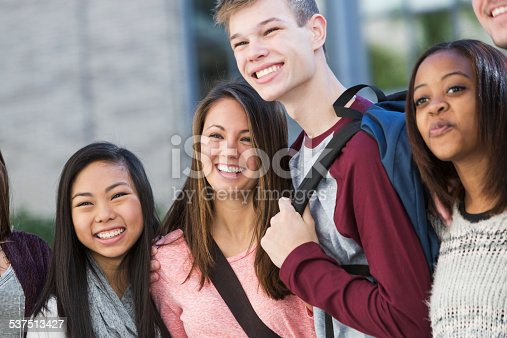 istock Group of students standing in a row outdoors 537513427