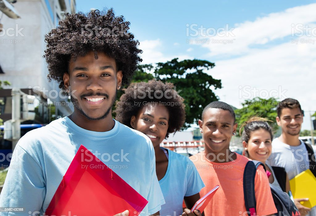 Group of students standing in line stock photo