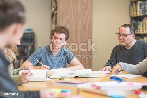 istock Group of students study diligently in university library 680254054