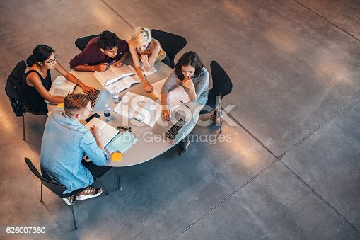 istock Group of students studying on laptop 626007360