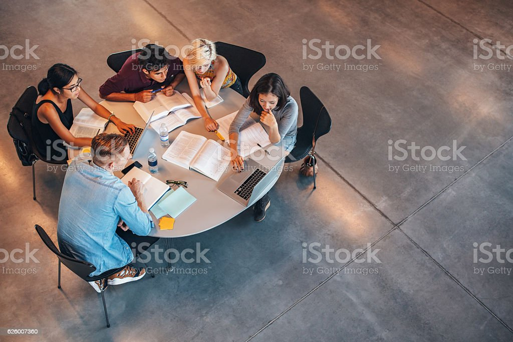 Group of students studying on laptop stock photo