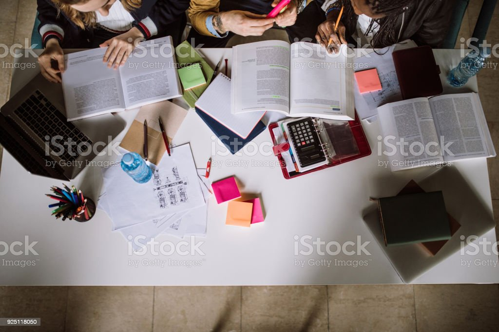 Group Of Students Studying Together in reading room stock photo
