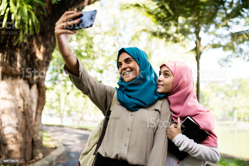 Group of students using mobile phone stock photo