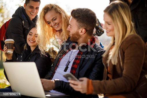 istock Group of students using technology on university campus 1037656274