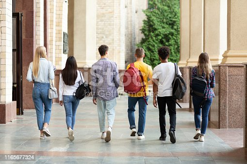 istock Group of students walking in college campus after classes 1165677324