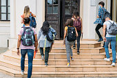 istock Group of students walking in college 1269075734