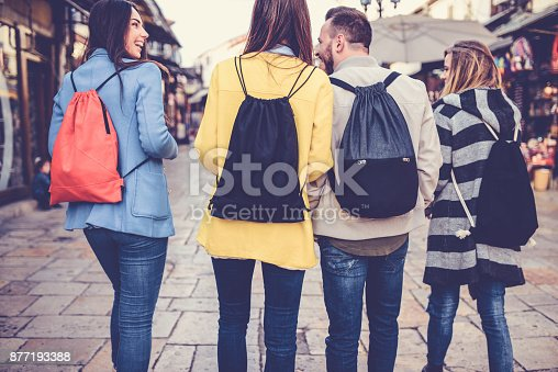 872670290istockphoto Group of Students with Backpacks Walking After School 877193388
