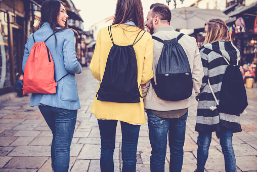 872670290 istock photo Group of Students with Backpacks Walking After School 877193388