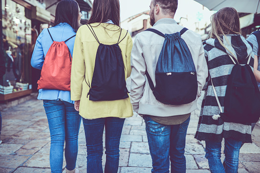 872670290 istock photo Group of Students with Backpacks Walking After School 899457732