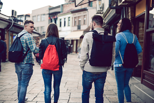 872670290 istock photo Group of Students with Backpacks Walking After School 909209148