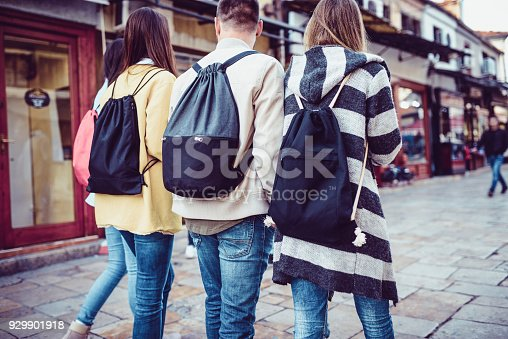 872670290istockphoto Group of Students with Backpacks Walking After School 929901918