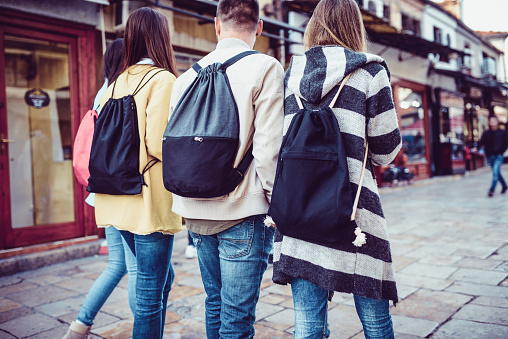872670290 istock photo Group of Students with Backpacks Walking After School 929901918