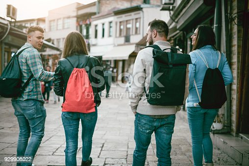 872670290istockphoto Group of Students with Backpacks Walking After School 929908022