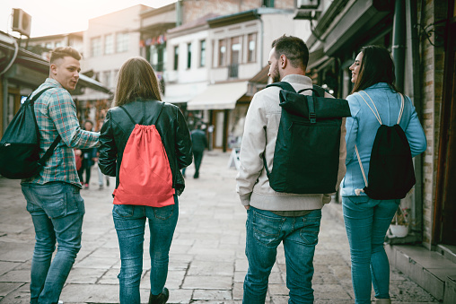 872670290 istock photo Group of Students with Backpacks Walking After School 929908022