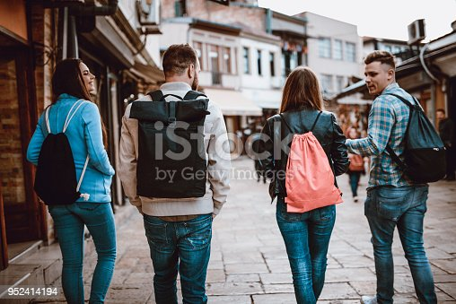 872670290istockphoto Group of Students with Backpacks Walking After School 952414194