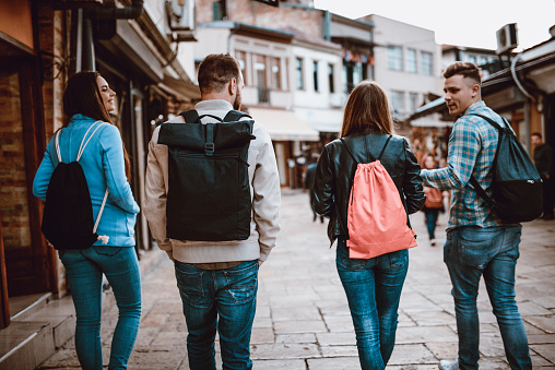 872670290 istock photo Group of Students with Backpacks Walking After School 952414194