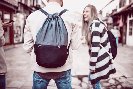 872670290 istock photo Group of Students with Backpacks Walking After School 952415494