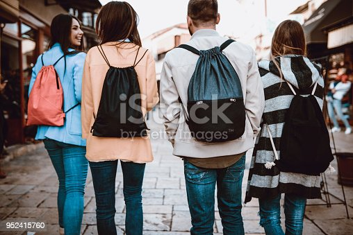 872670290istockphoto Group of Students with Backpacks Walking After School 952415760