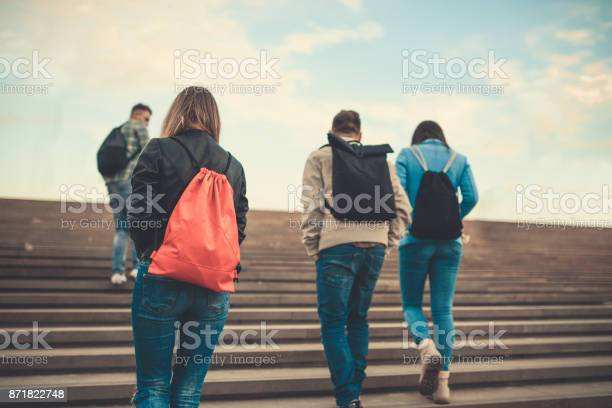 Group of students with backpacks walking to school picture id871822748?b=1&k=6&m=871822748&s=612x612&h=jpcudeew8k4z39nuuydgx7lkkwqz6bprealotoghxx4=