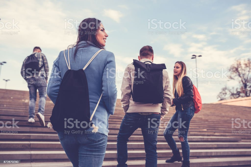 Group of Students with Backpacks Walking to School стоковое фото