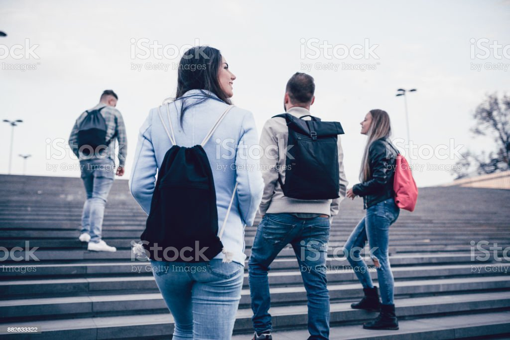 Group of Students with Backpacks Walking to School stock photo
