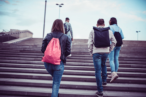 872670290 istock photo Group of Students with Backpacks Walking to School 898999328