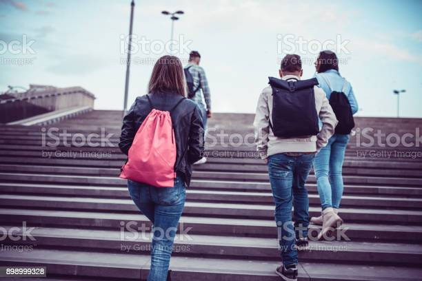 Group of students with backpacks walking to school picture id898999328?b=1&k=6&m=898999328&s=612x612&h=3ethwp3oihzmwz7ir6z0crryc05zqnnjfhiqrltyaw0=