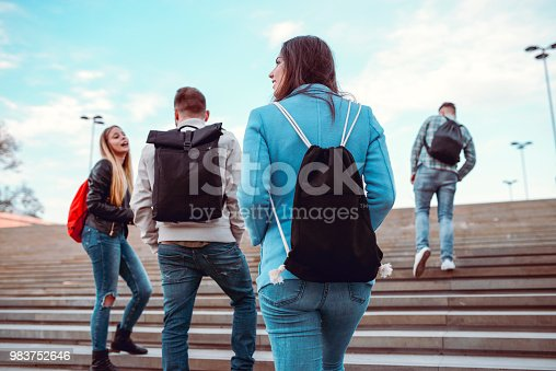 872670290istockphoto Group of Students with Backpacks Walking to School 983752646