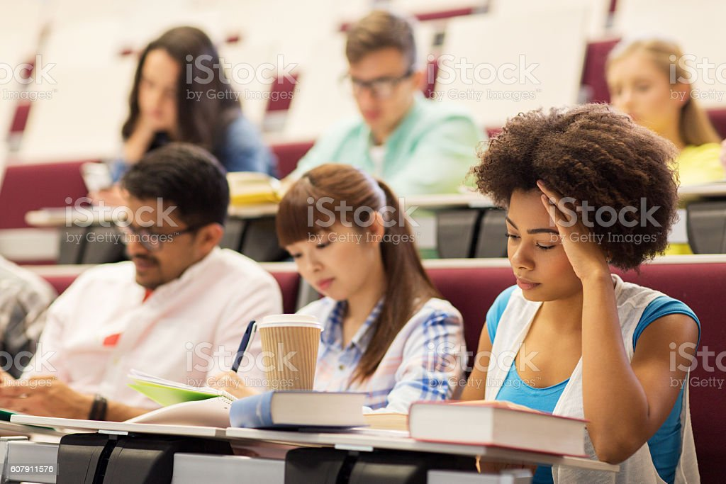 group of students with coffee writing on lecture – Foto