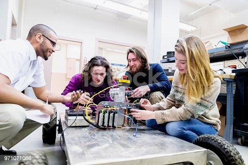University Students having discussion over their final semester project at a Science Laboratory
