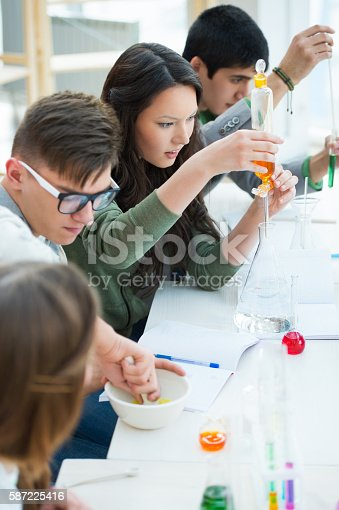 1097006206 istock photo Group of students working together at laboratory 587225416