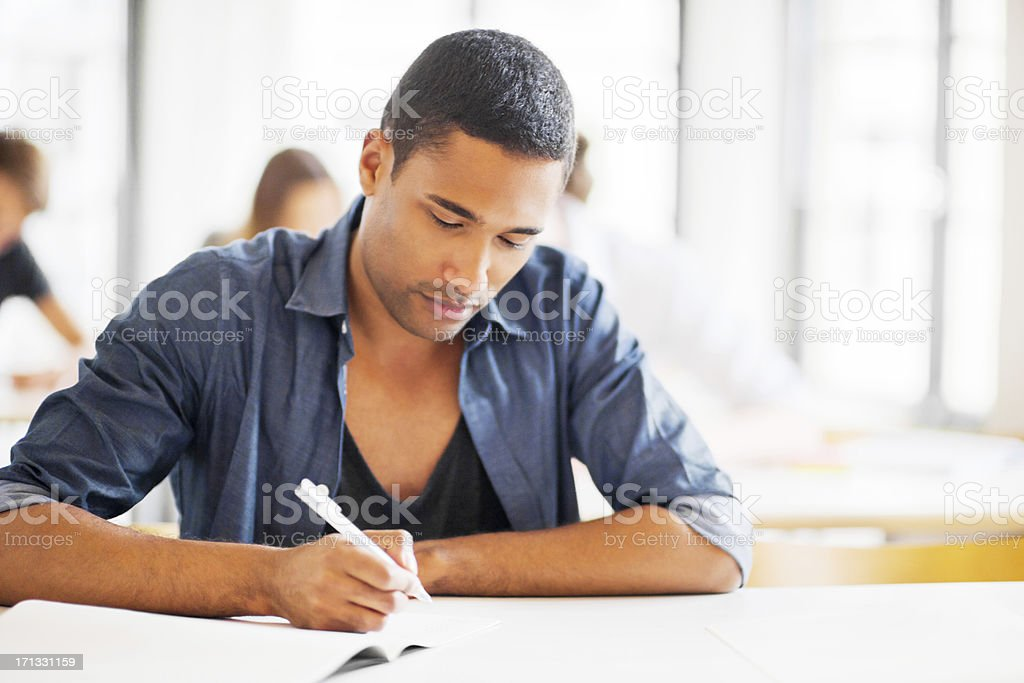 Group of students writing in the classroom. royalty-free stock photo