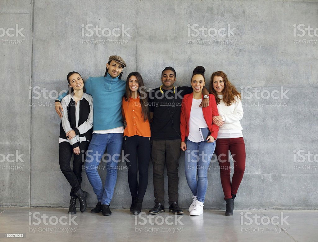 Group of stylish young university students on campus stock photo