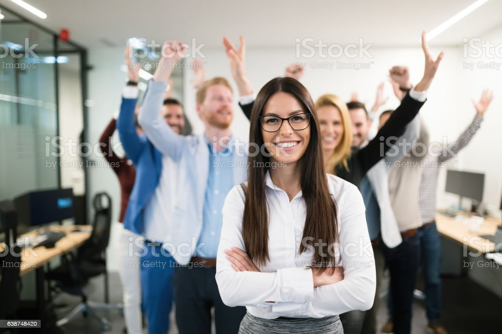 Group of successful business people happy in office royalty-free stock photo