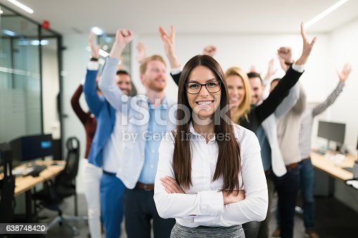 istock Group of successful business people happy in office 638748420
