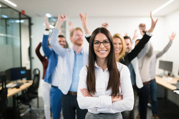 Group of successful business people happy in office stock photo