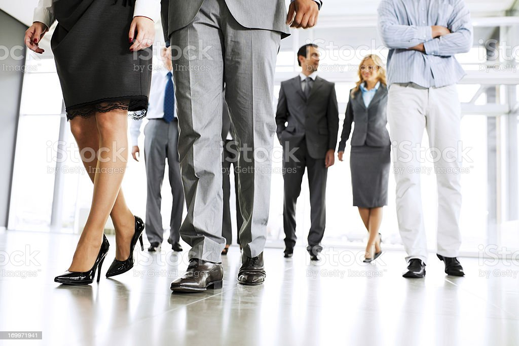 Group of successful businesspeople entering the building. stock photo