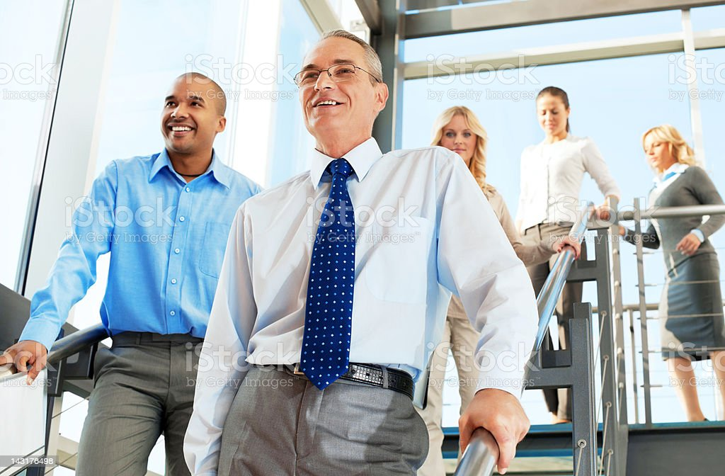 Group of successful businesspeople on the staircase. royalty-free stock photo