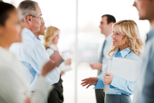 514325215 istock photo Group of successful businesspeople standing and talking 169950308